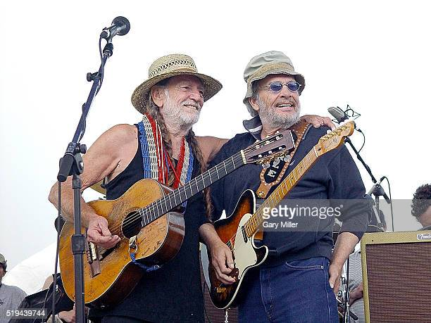 Merle Haggard performs with Willie Nelson during Willie Nelson's 4th of July Picnic at the Spicewood Springs Amphitheater on July 4 2003 in Austin...