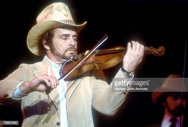 Merle Haggard plays fiddle onstage in March 1980 in Los Angeles California