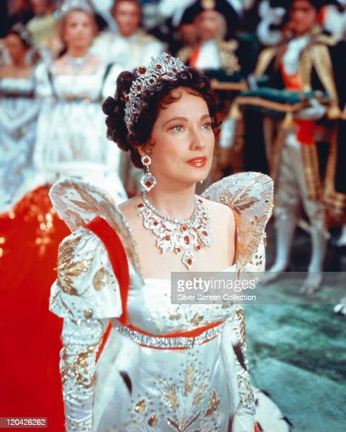 Merle Oberon British actress in period costume with a diamond tiara ornate necklace and earrings in the coronation scene in a publicity still issued...