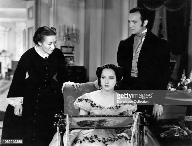 Merle Oberon Flora Robson and David Niven in a scene from the movie Wuthering Heights