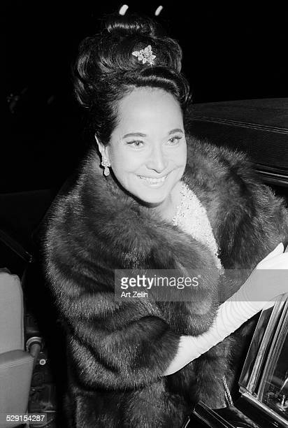 Merle Oberon wearing a fur getting into a limousine circa 1970 New York