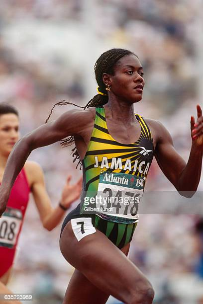Merlene Ottey from Jamaica competes in the women's 200meter sprint at the 1996 Olympic Games