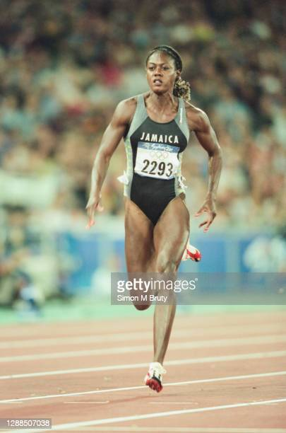 Merlene Ottey of Jamaica in action during the heats for the Women's 100m at the Olympic Stadium during the Sydney 2000 Olympic Games on September...