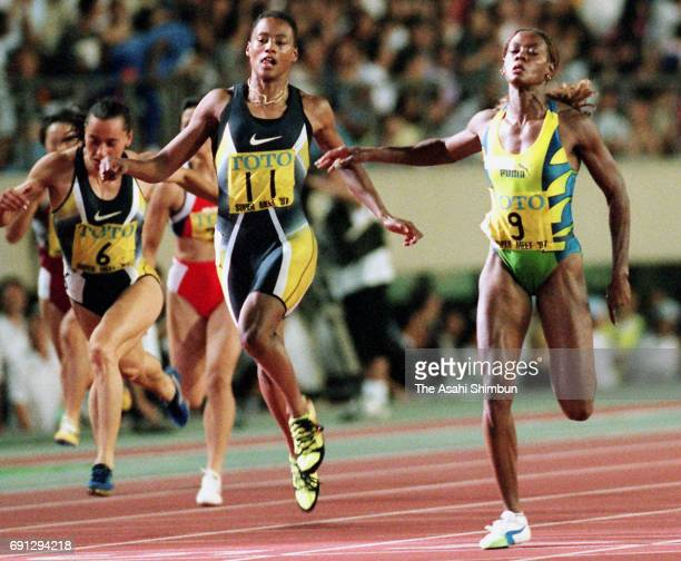 Merlene Ottey of Jamaica reacts after winning the Women's 100m during the TOTO Super Track & Field at the National Stadium on September 6, 1997 in...