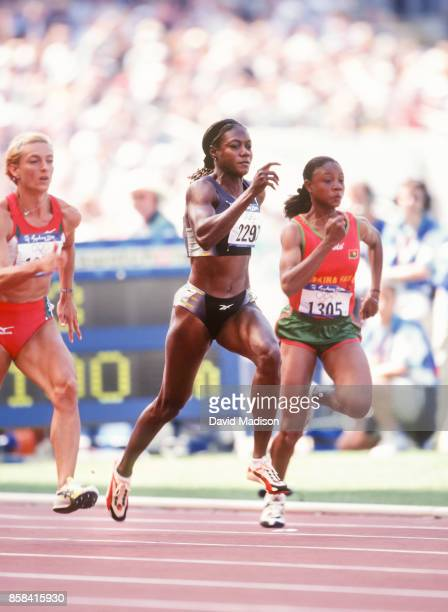 Merlene Ottey of Jamaica runs a first round race of the Women's 100 meter event of the 2000 Olympic Games on September 22, 2000 at Olympic Stadium in...