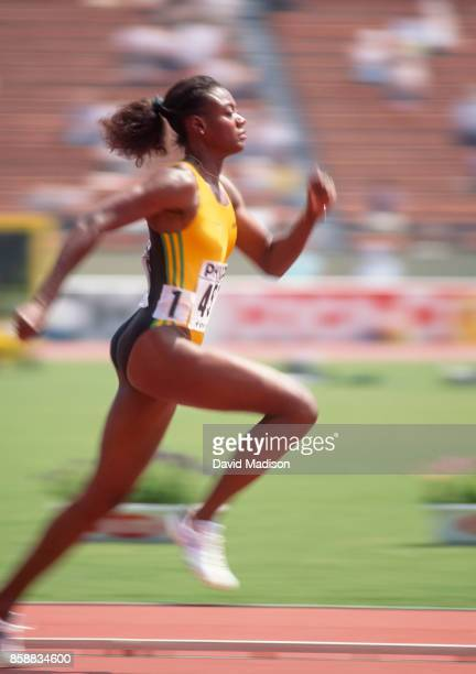 Merlene Ottey of Jamaica runs a preliminary heat of the Women's 100 meter race of the 1991 IAAF World Championships on August 26 1991 at the National...