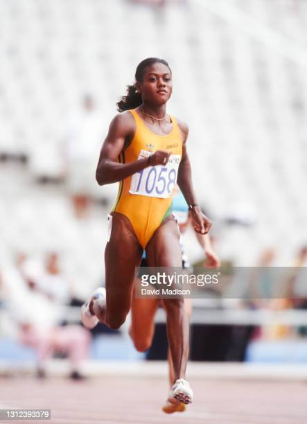 Merlene Ottey of Jamaica runs in the second round of the Women's 200 meters race of the Athletics competition of the 1992 Summer Olympics on August...