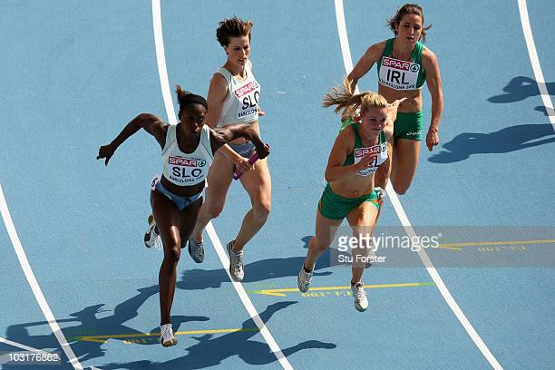 Merlene Ottey of Slovenia and Ailis Mcsweeney of Ireland compete in the 4x100m Womens Relay Heats during day five of the 20th European Athletics...