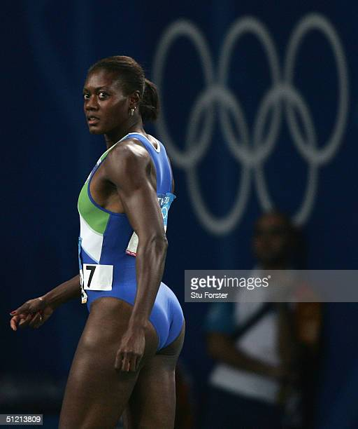 Merlene Ottey of Slovenia leaves the track after she pulled out before the women's 200 metre semifinal on August 24, 2004 during the Athens 2004...