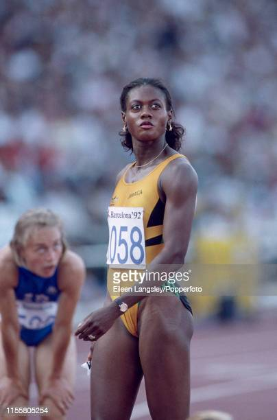 Merlene Ottey representing Jamaica looks towards the big screen after the women's 200 metres final during the 1992 Summer Olympics at the Olympic...