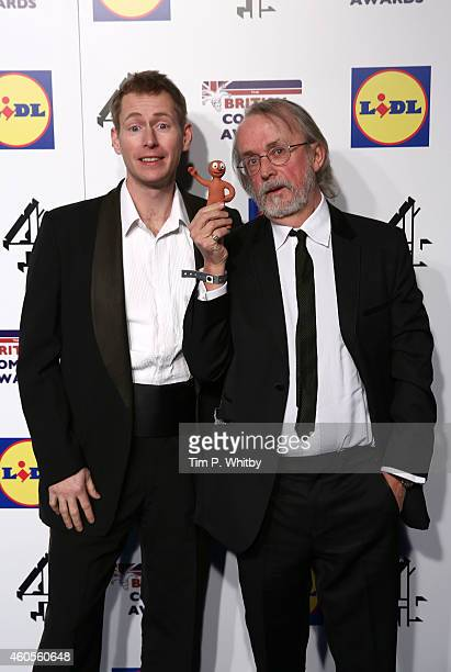 Merlin Corossingham and the creator of 'Morph' Peter Lord attend the British Comedy Awards at Fountain Studios on December 16 2014 in London England