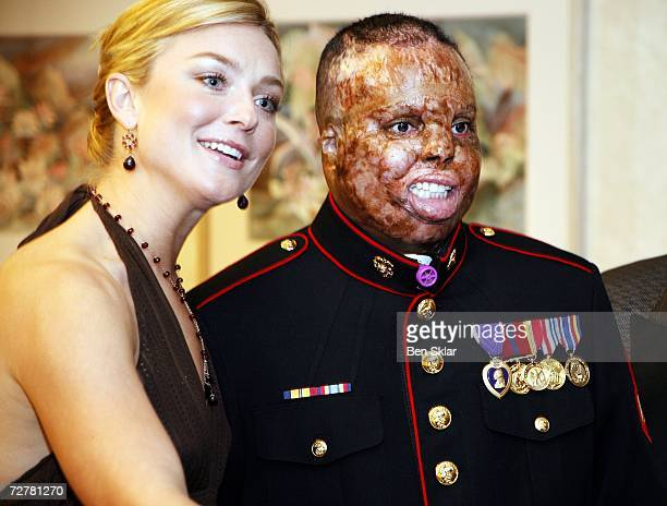 Merlin German of New York poses for a photo with actress Elisabeth Rohm at a Brooke Army Medical Center holiday ball on December 8 2006 in San...