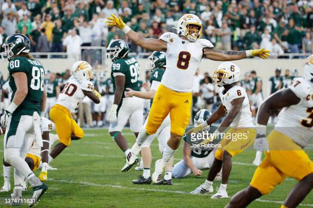 Merlin Robertson of the Arizona State Sun Devils celebrates after a missed field goal by the Michigan State Spartans as time expired in the game at...
