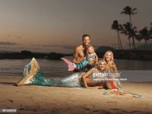 Mermaid performers Hannah Fraser and Kari JoAllen are photographed for Paris Match on December 16 2013 in Kailua Hawaii