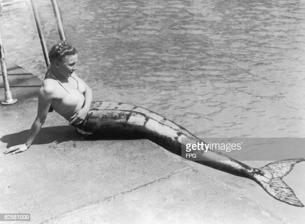 Mermaid sitting by a pool's edge in Scotland, 1949.