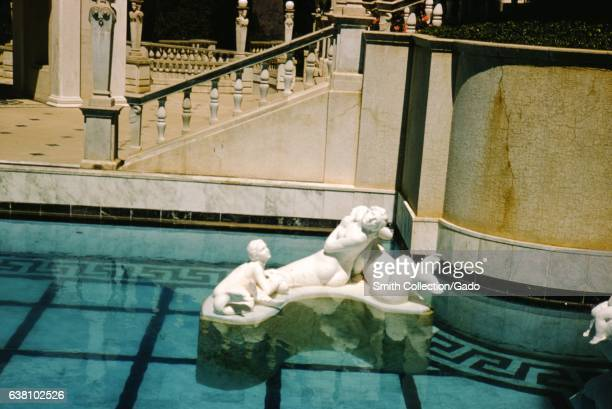A mermaid statue sits on top of a platform in the Neptune Pool at Hearst Castle San Simeon California 1960