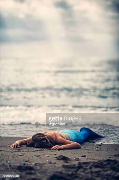 mermaid washed up on beach - dead girl stock pictures, royalty-free photos & images