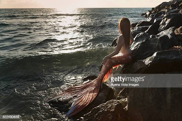 Mermaid watching  sunset