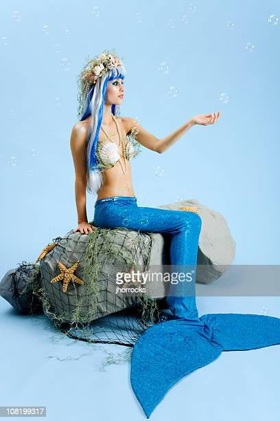 mermaid with falling bubbles - mermaid stock photos and pictures
