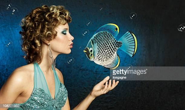 Mermaid Woman Kissing Fish