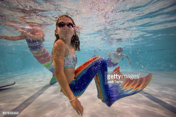 Mermaiding students swim in their tails during a Mayim Mermaid Academy lesson at the swimming pool at Bournemouth Collegiate School on August 19 2017...