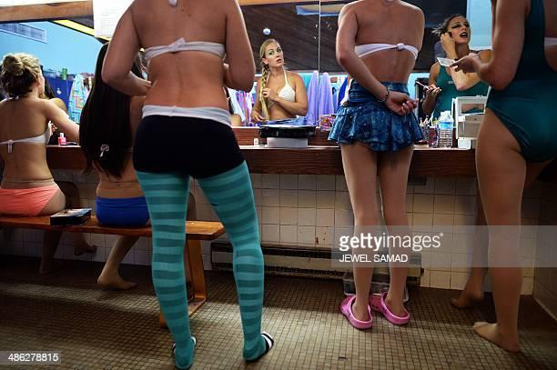 'Mermaids' get ready in the dressing room before their underwater show 'Little Mermaid' at Weeki Watchee Springs State Park on April 24 2014 in Weeki...