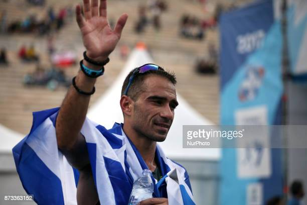 Merousis Hristoforos covered with the greek flag at the 35th Athens Classic Marathon in Athens Greece November 12 2017