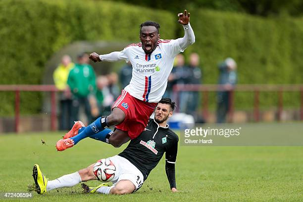 Merphi Kwatu of Hamburg and Florian Grillitsch of Bremen compete for the ball during the Regionalliga Nord match between Hamburger SV II and Werder...