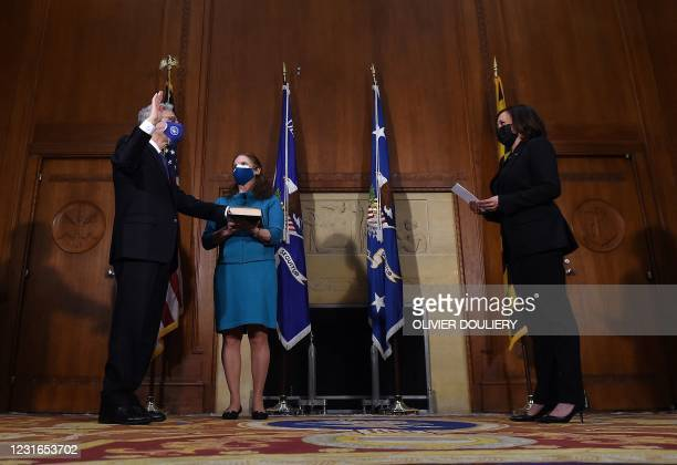 Merrick Garland is ceremonially sworn in as US attorney general by US Vice President Kamala Harris as his wife Lynn Garland looks on, at the US...