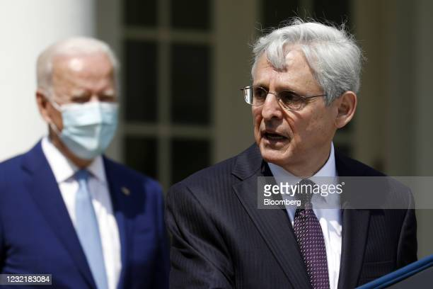 Merrick Garland, U.S. Attorney general, speaks as U.S. President Joe Biden, left, listens in the Rose Garden of the White House in Washington, D.C.,...