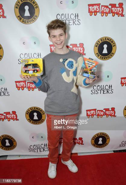 Merrick Hanna attends The Couch Sisters 1st Annual Toys For Tots Toy Drive held onNovember 20 2019 in Glendale California