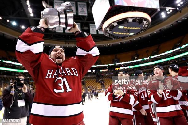 Merrick Madsen of the Harvard Crimson celebrates after the Crimson defeat the Boston University Terriers 6-3 in the 2017 Beanpot Tournament...