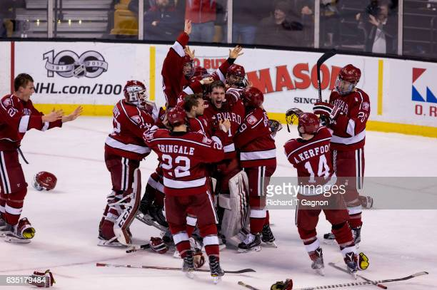 Merrick Madsen of the Harvard Crimson celebrates with teammates after beating the Boston University Terriers during NCAA hockey in the championship...