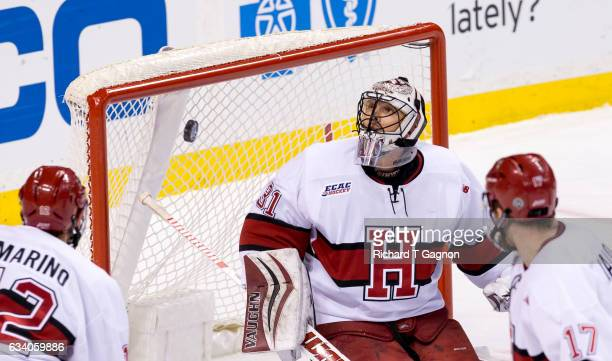 Merrick Madsen of the Harvard Crimson looks for the puck during NCAA hockey in the semifinals of the annual Beanpot Hockey Tournament against the...