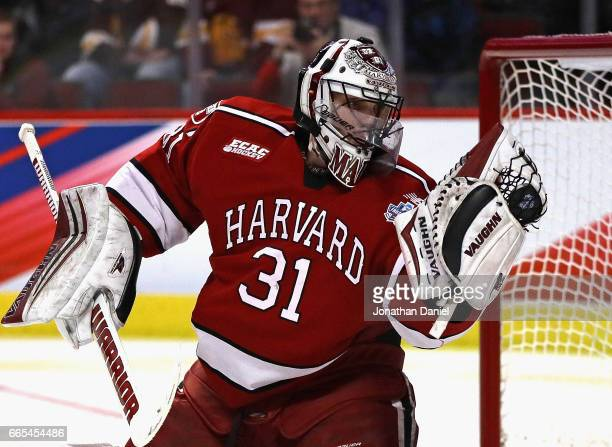 Merrick Madsen of the Harvard Crimson makes a glove save against Minnesota-Duluth Bulldogs during game one of the 2017 NCAA Division I Men's Hockey...