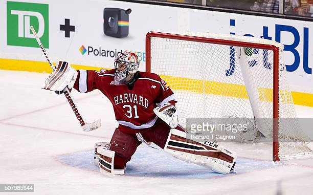 Merrick Madsen of the Harvard Crimson makes a save against the Boston College Eagles during NCAA hockey in the semifinals of the annual Beanpot...