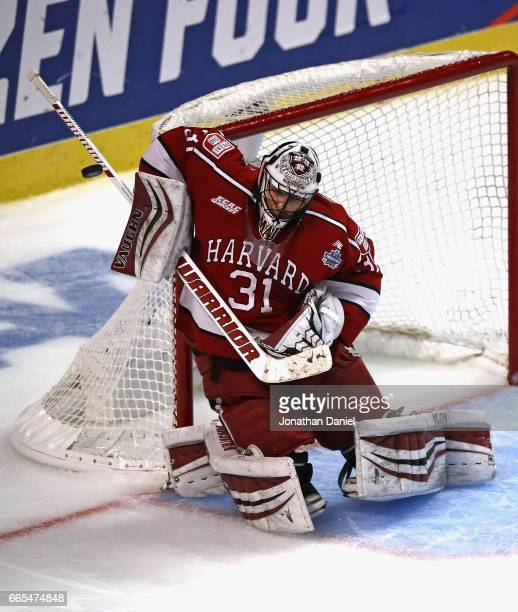 Merrick Madsen of the Harvard Crimson makes a save against the Minnesota-Duluth Bulldogs during game one of the 2017 NCAA Division I Men's Hockey...