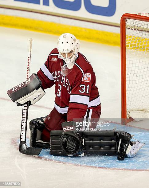 Merrick Madsen of the Harvard Crimson makes a save in warm-ups before NCAA hockey against the Boston College Eagles at Kelley Rink on November 11,...
