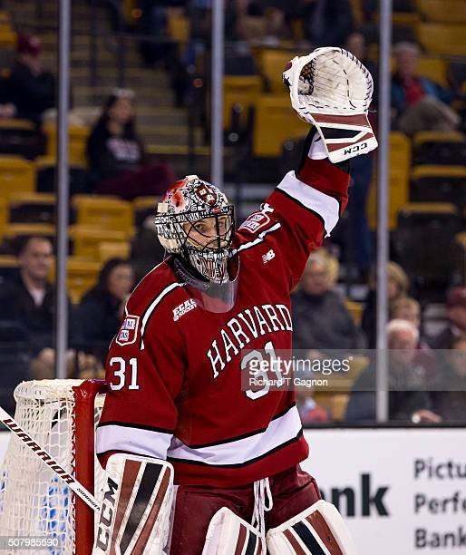 Merrick Madsen of the Harvard Crimson signals for an icing call against the Boston College Eagles during NCAA hockey in the semifinals of the annual...