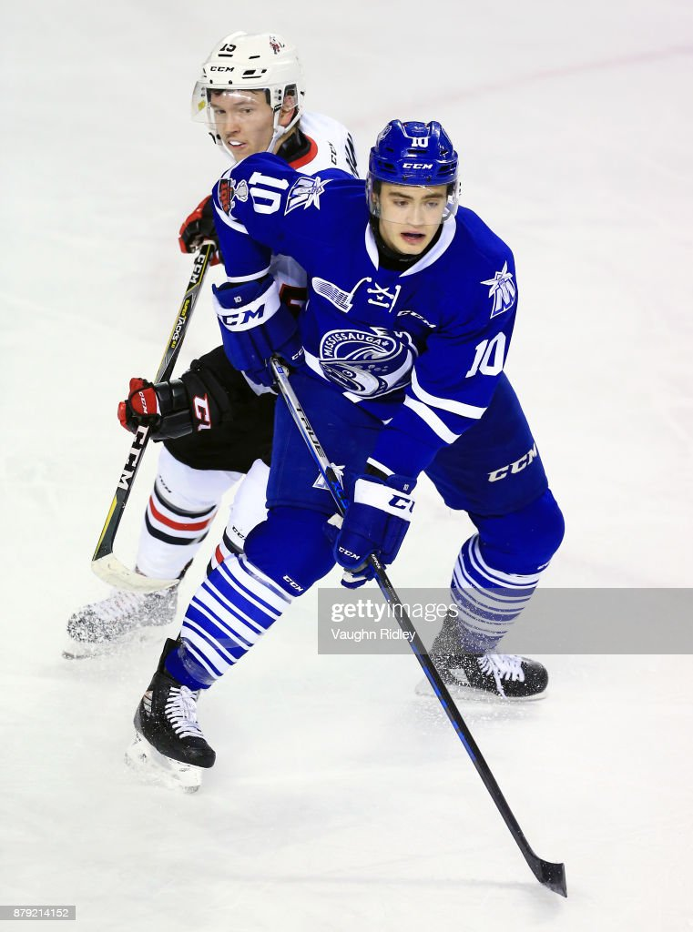 Merrick Rippon #10 of the Mississauga Steelheads battles with Oliver Castleman #15 of the Niagara IceDogs during the first period of an OHL game at the Meridian Centre on November 25, 2017 in St Catharines, Ontario, Canada.