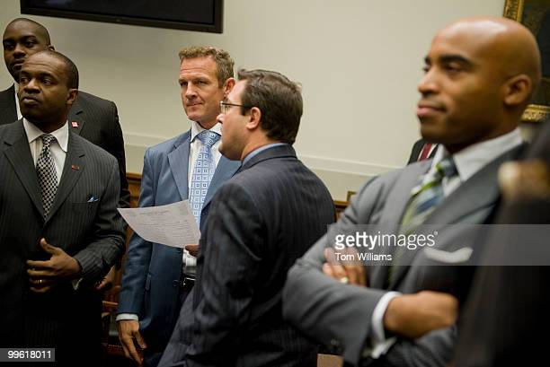 Merril Hoge third from left former player for the Steelers and Tiki Barber right former Giant prepare to testify at a House Judiciary Committee...