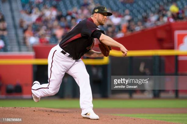 Merrill Kelly of the Arizona Diamondbacks delivers a pitch in the first inning of the MLB game against the San Francisco Giants at Chase Field on May...