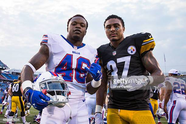 Merrill Noel of the Buffalo Bills and Jordan Dangerfield of the Pittsburgh Steelers pose for a portrait after a preseason game on August 29, 2015 at...