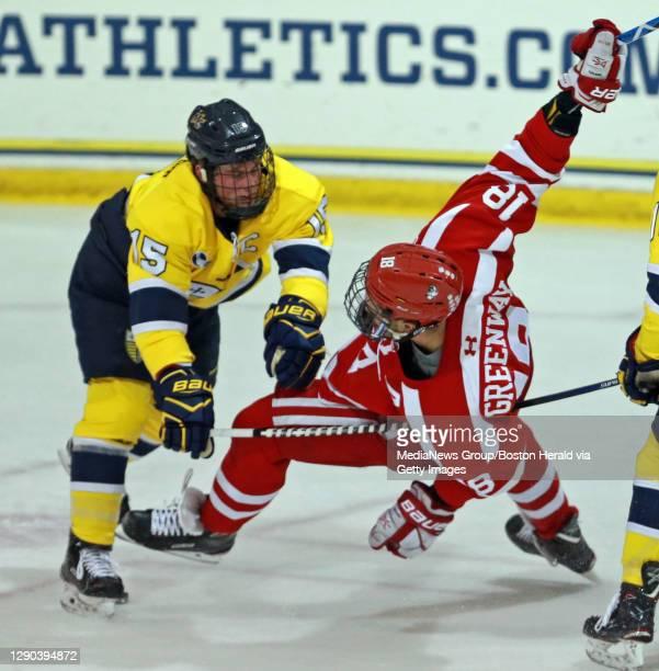 . Merrimack Warriors defenseman Jared Kolquist takes down Boston University Terriers forward Jordan Greenway as Merrimack takes on BU at Lawler...
