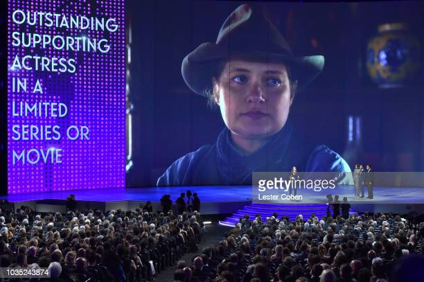 Merritt Wever accepts the award for Outstanding Supporting Actress in a Limited Series or Movie 'Godless' from presenters Chrissy Teigen and John...
