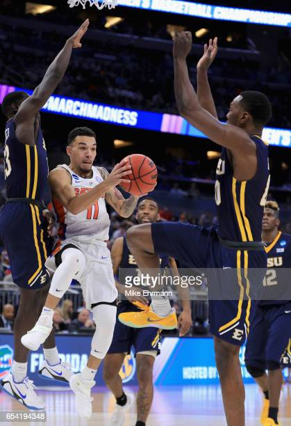 J Merriweather of the East Tennessee State Buccaneers tries to stop Chris Chiozza of the Florida Gators during the first round of the 2017 NCAA Men's...