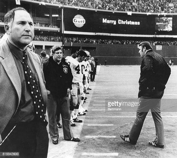 'Merry Christmas' flashes above Oakland Raider coach John Madden as he stalks from the field after losing to the Pittsburgh Steelers 13 to 7 A pass...