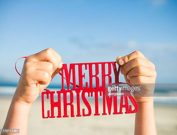 merry christmas from the beach - single word stock pictures, royalty-free photos & images