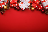 Merry christmas gift boxes background with christmas baubles