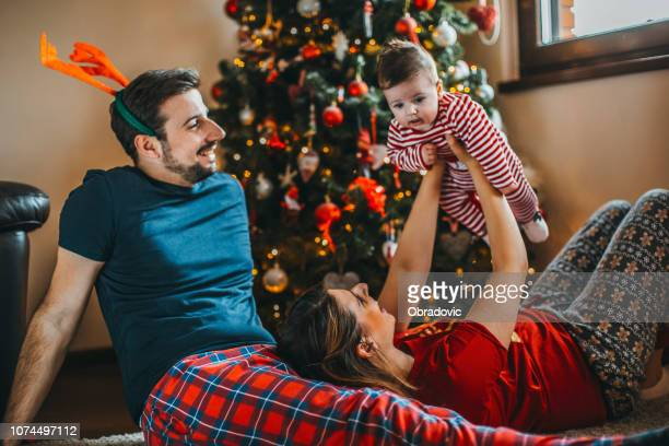 merry christmas! happy family mother father and child with gifts near tree - happy new month stock photos and pictures